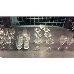 Shelf of etched wine glasses