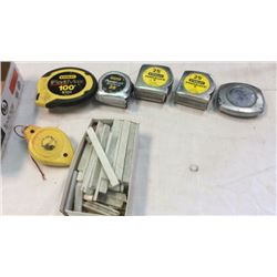 "5 ""Stanley"" tape measures , 1 chalk line, and b"