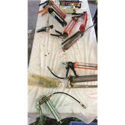 Lot of caulking guns and grease guns ( concrete,