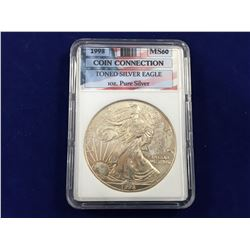 1997 USA Toned Silver Eagle MS60 In Slab
