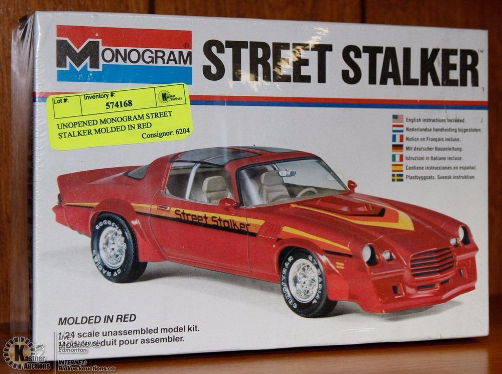 UNOPENED MONOGRAM STREET STALKER MOLDED IN RED