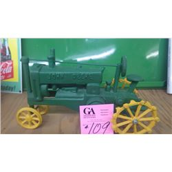 CAST IRON JOHN DEERE TOY TRACTOR WITH STEEL WHEELS
