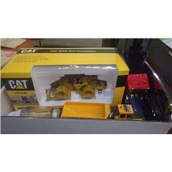 BOX WITH CAT COLLECTIBLE DIE CAST 825 H SOIL COMPACTOR IN BOX, VOLVO A25C DUMP TRUCK, 1955 FORD TOOT