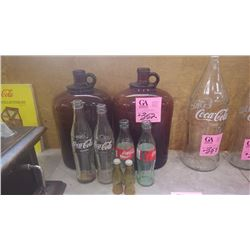TWO BROWN JUGS (ONE CRACKED), 4 VARIOUS SIZES COCA-COLA BOTTLES AND COCA-COLA SALT AND PEPPER SHAKER
