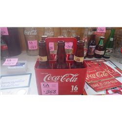 ONE PLASTIC COCA-COLA CARRIER WITH VINTAGE VARIOUS BEER BOTTLES