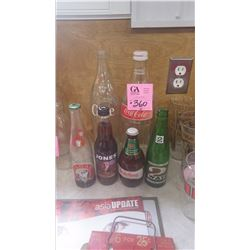 ONE 1.4 LTR PLUS 1 1.5 LTR COCA-COLA BOTTLES PLUS 4 MISC BOTTLES (ONE HEIDELBERG STUBBY)