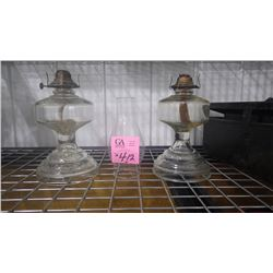SET OF 2 MATCHING CLEARCOAL OIL LAMPSAND ONE CHIMNEY (DEPRESSION ERA)