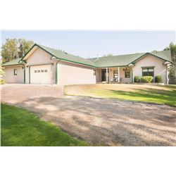 Gorgeous acreage with 2480 sq ft bungalow and 2 double attached heated garages with in floor heat. 2