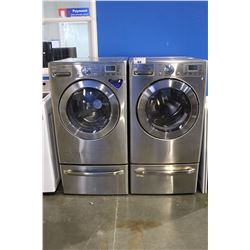 LG STAINLESS STEEL STEAM WASHER AND DRYER SET WITH PEDESTAL BASES