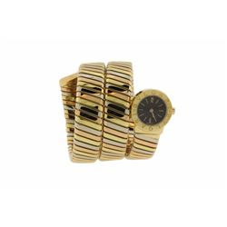 WATCH: [1] 18Kt tri gold ladies Bvlgari Snake Tubogas quartz watch with a black dial and a coil brac