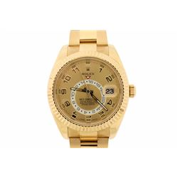 WATCH: [1] 18kt yellow gold Men's Rolex Oyster Perpetual Sky-Dweller wristwatch; Champagne numbered