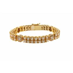 BRACELET:  [1] 10KYG bracelet set with 4 round diamonds, approx. 1.60 cttw., good/ G-H/ I1; and 106