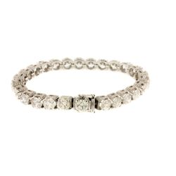 BRACELET:  [1] 18KWG tennis style bracelet with pave diamonds set in 26 settings, TWA 3.60 cts, H/I,