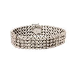 BRACELET: 10kt white gold diamond bracelet set with round brilliant cut diamonds, estimated 11.75 ct