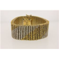 BRACELET:  [1] 10KY & WG bracelet set with 772 round diamonds, approx. 34.25 cttw., good/ H-J and tr