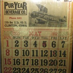 "May 1932 Calendar Page measuring 20.5"" x 26.5"" advertising for ""Pur Year Beverage Co. Phone 641 13th"