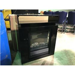 "SMALL BLACK ELECTRIC  FIREPLACE MEASURES  27""W X  32""H X 12""D"