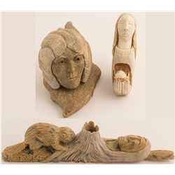 Three Native American carvings