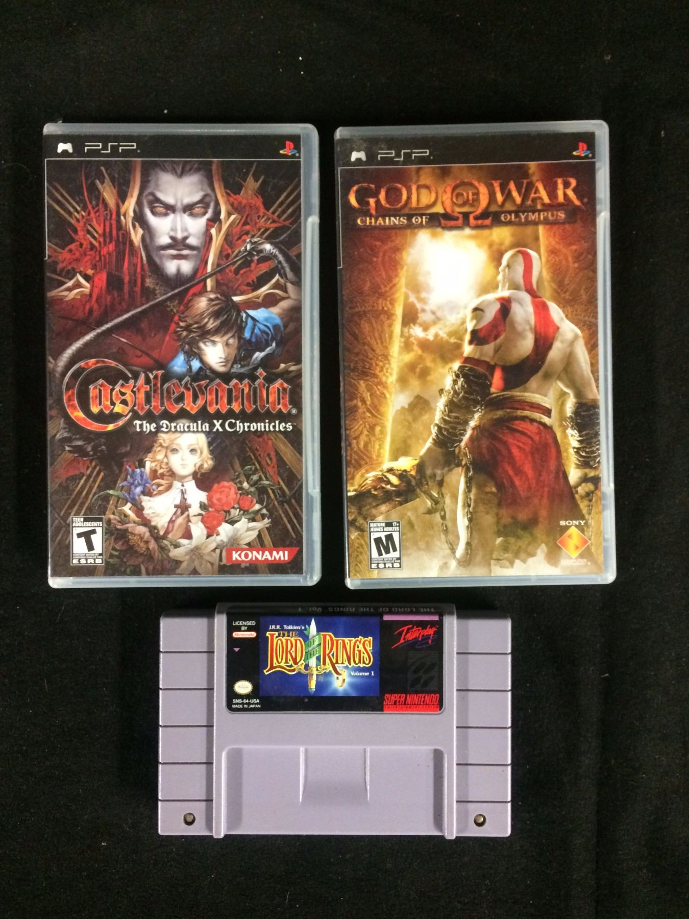 PSP & SUPER NINTENDO VIDEO GAME LOT (CASTLEVANIA, GOD OF WAR, LORD OF THE  RINGS)