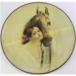 """Early tin charger with great artwork of girl and horse, unmarked, 16"""" diameter.  Est. 75-175"""