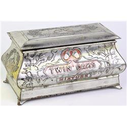 "Original Twin Oaks tobacco tin casket humidor in nice original condition, 8 1/2"" long.  Est. 50-100"