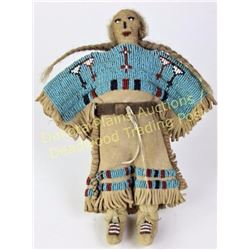 """Northern Plains beaded on leather doll 8"""" tall, sinew sewn with white centered reds, blues and white"""