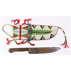Large Sioux beaded knife sheath with knife. Sheath finely beaded in small seed beads with classic ge