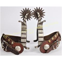 """Rex Schnitger spurs (1877-1977) single mounted spurs with 1"""" heel bands, 2 3/4"""" shanks and 16 point"""