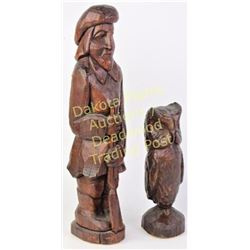 """Two vintage South Dakota wood carvings bottoms with paper tags marked Eng's Studio Hill City """"The Bu"""