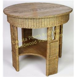 """Wicker and oak round parlor table 33"""" round top with lower shelf.  Est. 50-100"""