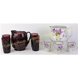 Collection of 2 antique lemonade sets, the first in purple amethyst glass with 4 tumblers the second