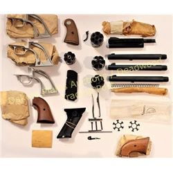 Collection of new old stock Colt parts includes 3 aluminum Scout .22 back stamps, 2 pair Scout walnu