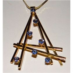 Yogo Sapphire pendent, 7 rd brilliant Yogos, all approx. .30 ct each, 14 kt yellow gold