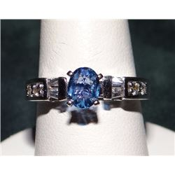 Yogo Sapphire ladies ring with approx. .60 ct oval Yogo, (6.4 mm x 4.8 mm), with 4 x .05 rd diamonds