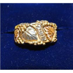 Black Hills Gold ring with 3 small diamonds, size 5
