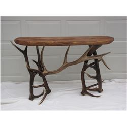 Gorgeous hand crafted sofa table made from elk antlers with a mesquite wood top. Since the late 80's