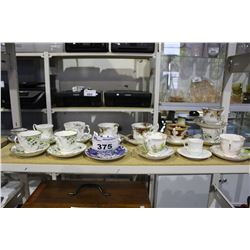 SHELF LOT OF CUPS AND SAUCERS