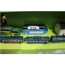 SHELF LOT OF H.O AND LIONEL  MODEL TRAIN PIECES AND 4 2 SCALE HAND PAINTED BUILDINGS