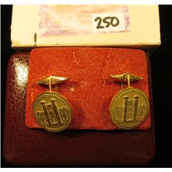 Pair of Gold-plated Cuff Links depicting the Royal Canadian Mint. In original box of issue.