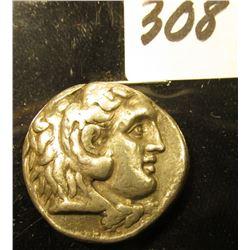 Alexander the Great Silver Tetradrachm. 3rd Century B.C. Obv. Head of young Herakles r., clad in Nem