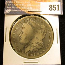 1892 S U.S. Morgan Silver Dollar, VG. Slight dark toning streak.