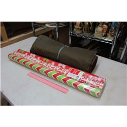 Camping Mattress And Unused Christmas Wrapping Paper