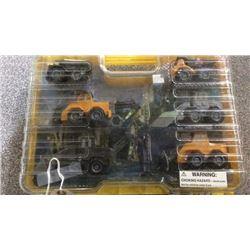6 toy trucks in case