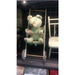 Doll stroller with bear