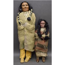TWO SKOOKUM DOLLS