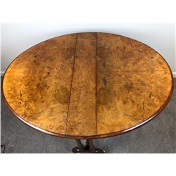 c1850 Flame Walnut Oval Sutherland Table Upon turned tapering supports, on shaped sledge feet connec
