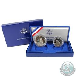1986 United States Liberty Half Dollar & Dollar Proof Set in blue Presentation Case.