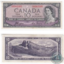 1954 Devil's Face $10.00 Note in EF-AU. There are two pinholes to the left side of the note.