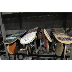 SHELF LOT OF SKATEBOARDS