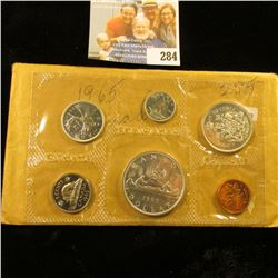 1965 CANADIAN MINT SET.  THE DOLLAR, HALF DOLLAR, QUARTER, AND DIME ARE SILVER